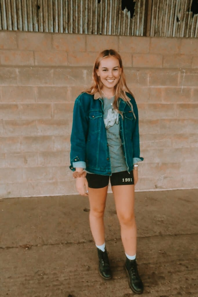 Cycling shorts, denim jacket and graphic tee | How to Wear a Graphic Tee